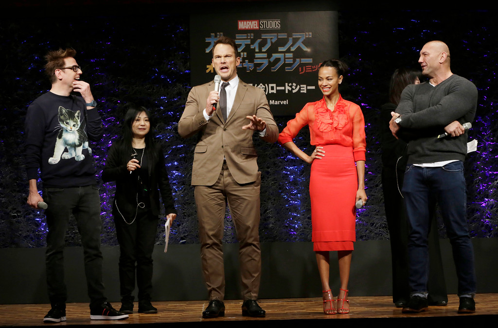 ". Director James Gunn, left, American actors Chris Pratt, center, Zoe Saldana, second right, and Dave Bautista, right, attend a media conference of ""Guardians of the Galaxy Vol. 2\"" in Tokyo, Tuesday, April 11, 2017. (AP Photo/Eugene Hoshiko)"