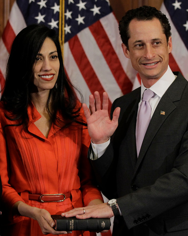 . File - Rep. Anthony Weiner, D-N.Y., and his wife, Huma Abedin, aide to Secretary of State Hillary Rodham Clinton, are pictured after a ceremonial swearing in of the 112th Congress on Capitol Hill in Washington, Wednesday, Jan. 5, 2011. Abedin said Monday, August 29, 2016,  that she is separating from her husband, Anthony Weiner, after the former congressman was accused in yet another sexting scandal. (AP Photo/Charles Dharapak)