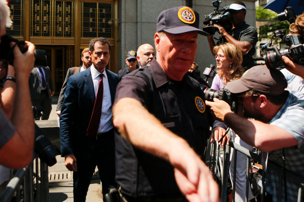 . NEW YORK, NY - May 19: Former Democratic Congressman Anthony Weiner (L) exits federal court in Manhattan after pleading guilty in sexting case on May 19, 2017 in New York City.  Weiner, who resigned from Congress over a sexting scandal, pleaded guilty on friday to federal charges of transmitting sexual material to a minor and could face a prison term. (Photo by Eduardo Munoz Alvarez/Getty Images)