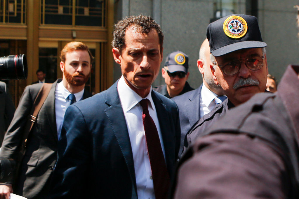 . NEW YORK, NY - May 19: Former Democratic Congressman Anthony Weiner (C) exits federal court in Manhattan after pleading guilty in sexting case on May 19, 2017 in New York City.  Weiner, who resigned from Congress over a sexting scandal, pleaded guilty on friday to federal charges of transmitting sexual material to a minor and could face a prison term. (Photo by Eduardo Munoz Alvarez/Getty Images)