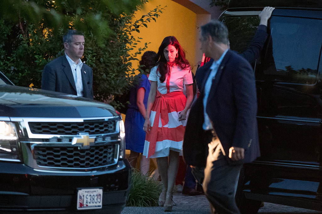 . In this photo taken Aug. 28, 2016, Democratic presidential candidate Hillary Clinton\'s senior aid Huma Abedin, center, departs a fundraiser at a private home in Southampton, N.Y. Abedin says she is separating from husband Anthony Weiner after another sexting revelation involving the former congressman from New York.  (AP Photo/Andrew Harnik)