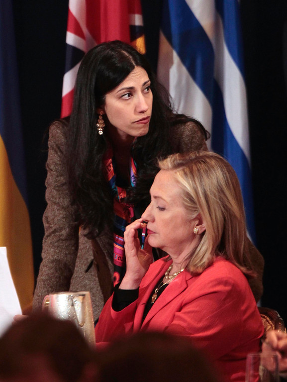 . Huma Abedin, deputy chief of staff and aide to Secretary of State Hillary Rodham Clinton, wife of former New York Rep. Anthony Weiner, rear, is seen during the Open Government Partnership meeting in New York, Tuesday, Sept., 20, 2011. Abedin said Monday, August 29, 2016,  that she is separating from her husband, Anthony Weiner, after the former congressman was accused in yet another sexting scandal. (AP Photo/Pablo Martinez Monsivais)