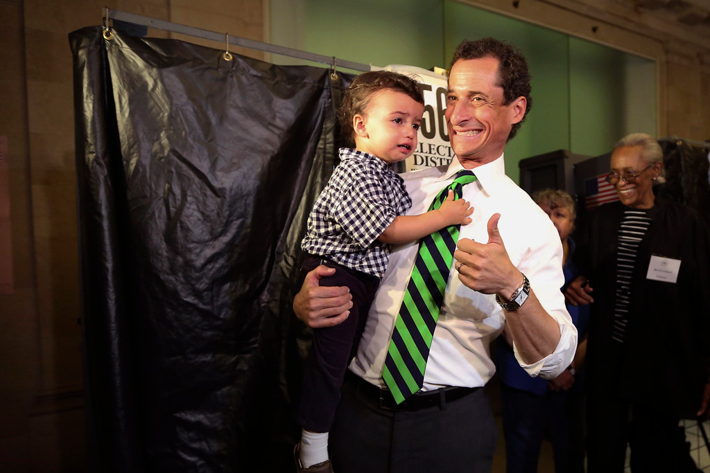 . Democratic mayoral hopeful Anthony Weiner holds his son Jordan as he leaves the voting booth after casting his vote at his polling station during the primary election in New York, Tuesday, Sept. 10, 2013.  (AP Photo/Mary Altaffer)