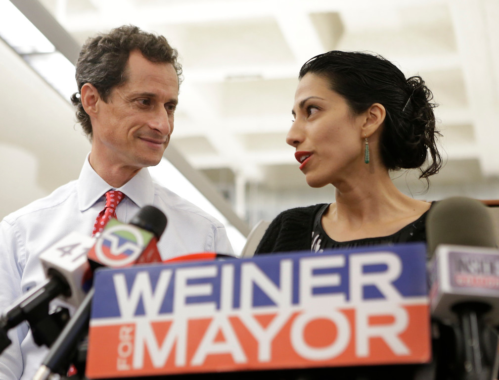 . FILE - In this July 23, 2013 file photo, Huma Abedin, alongside her husband, then-New York mayoral candidate Anthony Weiner, speaks during a news conference in New York. Democratic presidential candidate Hillary Clinton aide Huma Abedin says she is separating from husband Anthony Weiner after another sexting revelation involving the former congressman from New York.  (AP Photo/Kathy Willens, File)