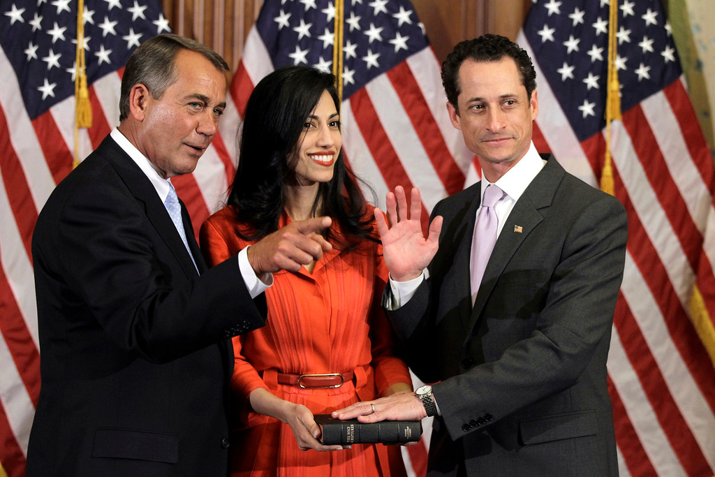 . FILE - In this Jan. 5, 2011, file photo House Speaker John Boehner of Ohio participates in a ceremonial swearing in with Rep. Anthony Weiner, D-N.Y., as his wife Huma Abedin on Capitol Hill in Washington. BAbedin said Monday, August 29, 2016,  that she is separating from her husband, Anthony Weiner, after the former congressman was accused in yet another sexting scandal. (AP Photo/Charles Dharapak)
