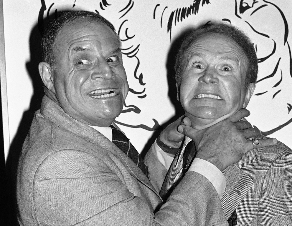 . FILE - In this Nov. 10, 1977 file photo, comedian Don Rickles, left, pretends to strangle fellow comedian Red Buttons prior to an Annual Stag Roast in Los Angeles. Rickles died Thursday, April 6, 2017, of kidney failure at his Los Angeles home. He was 90. (AP Photo/ Lennox McLendon, File)