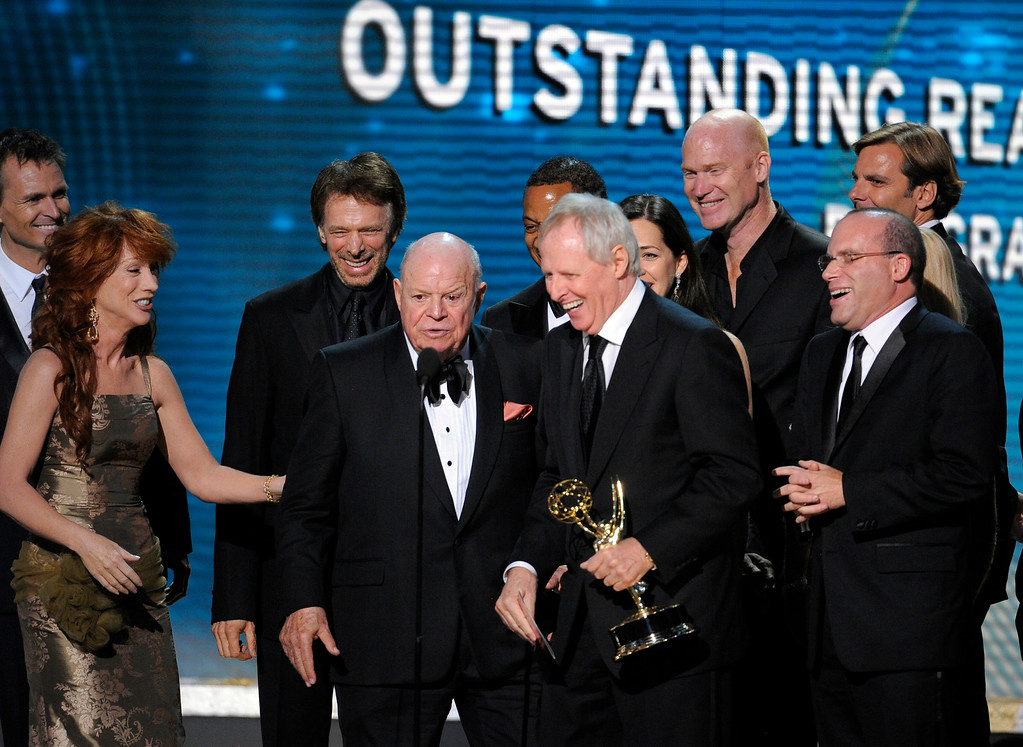 """. Executvie pruducer Bertram van Munster and other producers accept the award for the outstanding reality-competition program for \""""The Amazing Race\"""" from presenters Don Rickles and Kathy Griffin, left,at the 60th Primetime Emmy Awards Sunday, Sept. 21, 2008, in Los Angeles. (AP Photo/Mark J. Terrill)"""