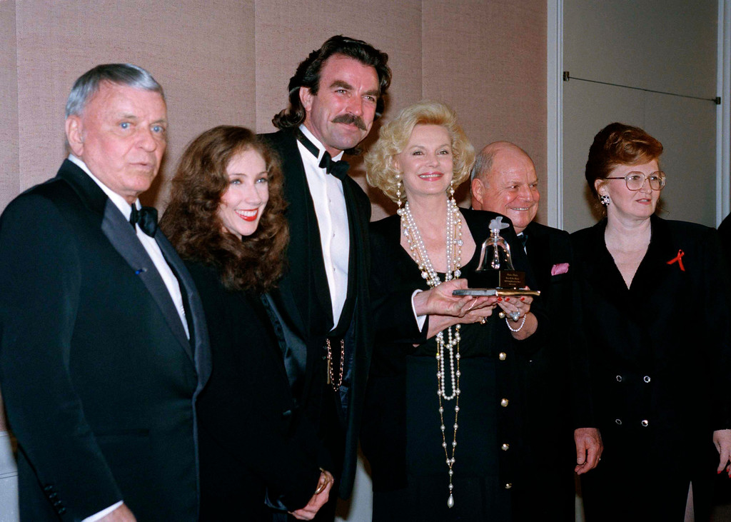 . Frank Sinatra poses with his wife, Barbara, second from right, who was presented the 1993 Women in Show Business Humanitarian Award by Tom Selleck, Sunday, March 21, 1993 in Los Angeles. Others attending the award ceremony include Jilly Mack Selleck, second from left, and Don Rickles, right. (AP Photo/Rhonda Birndorf)