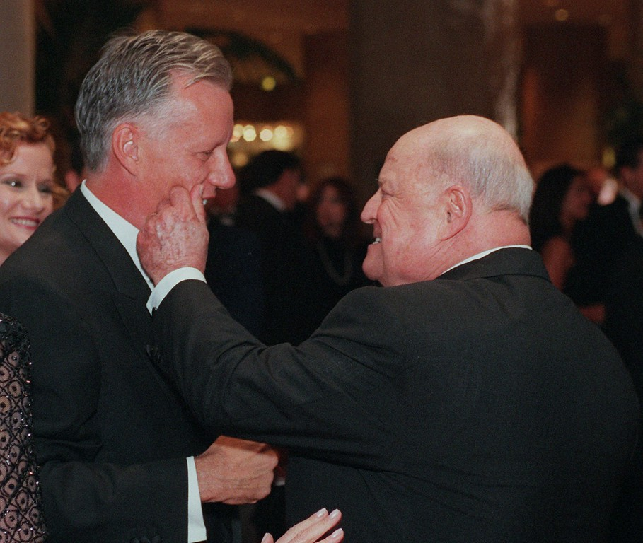 . Don Rickles, right, gives a friendly pinch on the cheek to fellow actor James Woods Friday, Oct. 23, 1998, at the arrivals of the Carousel of Hope fundraiser in Beverly Hills, Calif.    (AP Photo/John Hayes)