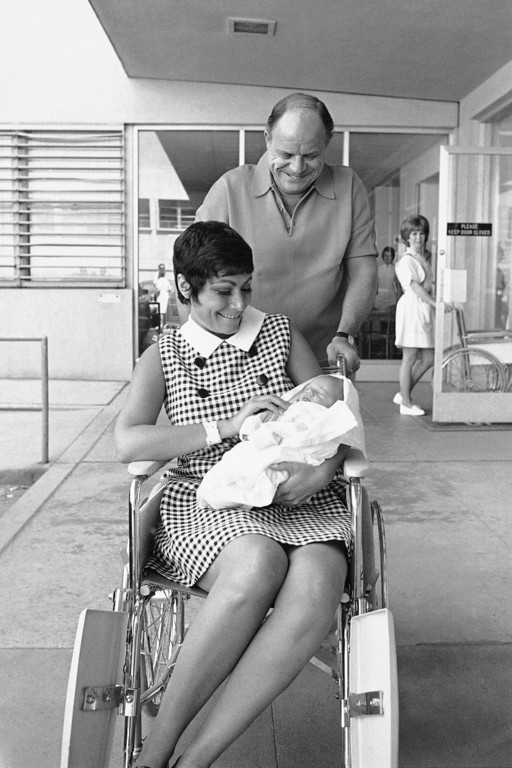 . File - Comedian Don Rickles, the King of Insults, appears almost ready to say something nice about his new offspring- Lawrence Corey Rickles- as baby and mother Barbara Rickles left Hollywood\'s Cedars of Lebanon Hospital in Hollywood, Los Angeles on May 15, 1970.    (AP Photo/ Harold Filan)