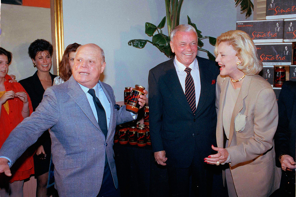 . Comedian Don Rickles pretends to throw a jar of Frank Sinatra\'s sugo da tavola Italian pasta sauce as Sinatra and his wife Barbara get a chuckle during the unveiling of his new sauce in a Los Angeles area restaurant, May 22, 1990.  (AP Photo/Bob Galbraith)