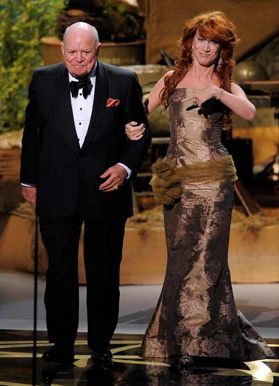 . Don Rickles and Kathy Griffin make the award presentation for outstanding reality-competition program at the 60th Primetime Emmy Awards in Los Angeles, Sunday, Sept. 21, 2008.  (AP Photo/Mark J. Terrill)