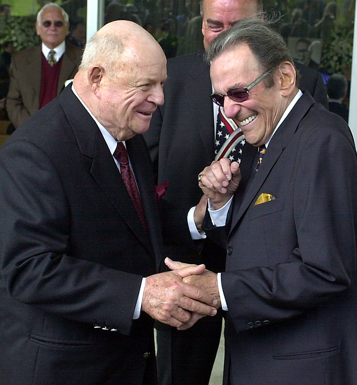. Comedians Don Rickles, left, and Norm Crosby arrive for a ceremony honoring comedian Milton Berle at Hillside Memorial Park and Mortuary in Los Angeles, Monday, April 1, 2002.  (AP Photo/Nick Ut)