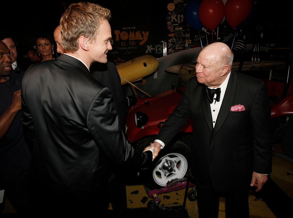 . Neil Patrick Harris, left, shakes hands  with Don Rickles backstage at the TV Land Awards on Sunday April 19, 2009 in Universal City, Calif. (AP Photo/Matt Sayles)