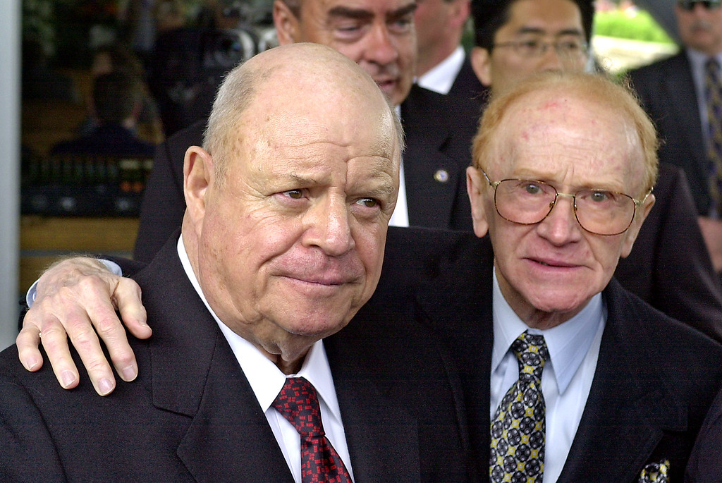 . Comedians Don Rickles, left, and Red Buttons arrive for a ceremony honoring comedian Milton Berle at Hillside Memorial Park and Mortuary in Los Angeles, Monday, April 1, 2002.   (AP Photo/Nick Ut)