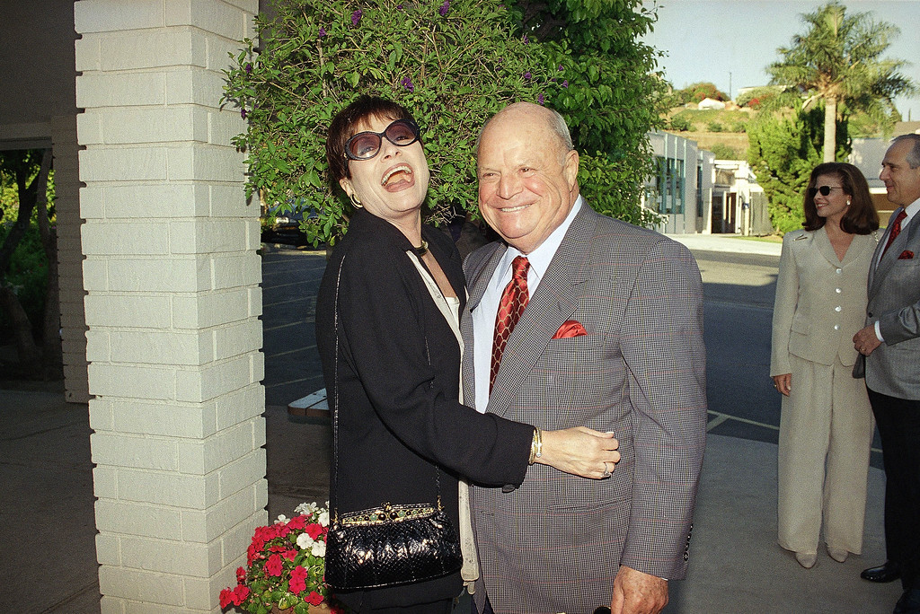 . Don Rickles and his wife Barbara arrive at Our Lady of Malibu church to celebrate Frank and Barbara Sinatra�s 20th wedding anniversary as they renew their wedding vows on Thursday, July 11, 1996 in Malibu, California. (AP Photo/Mark J. Terrill)