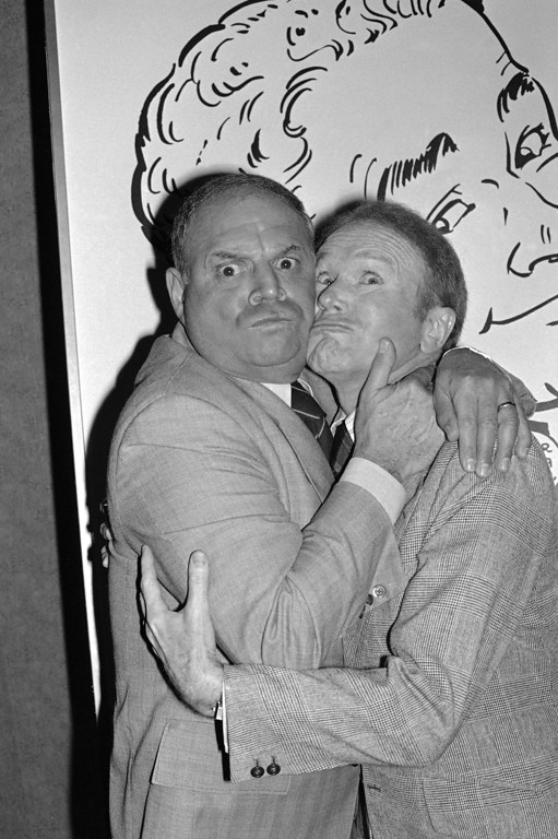 """. Comedian Don Rickles hugs Red Buttons as they clown for photographers prior to an Annual Stag Roast in Los Angeles on Thursday, Nov. 10, 1977. Rickles, the hollering, bald-headed \""""Merchant of Venom� whose barrage of barbs upon the meek and the mighty endeared him to audiences and his peers for decades died, Thursday, April 6, 2017 at his home in Los Angeles. He was 90. (AP Photo/LM)"""