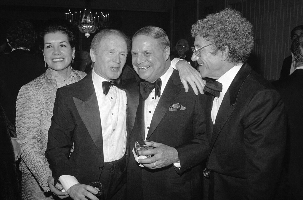 """. Veteran comedians Red Buttons and Don Rickles share the spotlight during a Friars Roast in Buttons? honor in Los Angeles on Nov. 15, 1982, during which the red-haired comic also received a Life Achievement award in commemoration of the years he has sent audiences into torrents of laughter with his litany of the famous who \""""never had a dinner.\"""" (AP Photo/Doug Pizac)"""