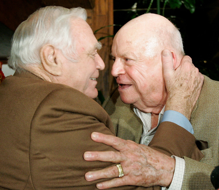. Ernest Borgnine, left, gets a hug from comedian Don Rickles during Borgnine\'s 90th birthday party at a restaurant in Los Angeles, Wednesday, Jan. 24, 2007. (AP Photo/Kevork Djansezian)