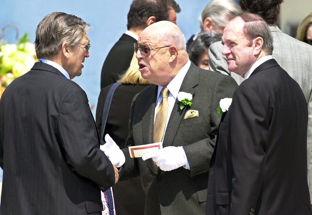 . Don Rickles, center, and Bob Newhart, right, talk with an unidentified man as they leave funeral services for former ``The Tonight Show Starring Johnny Carson\'\' executive producer Fred De Cordova at Holy Cross Cemetery in Culver City, Calif., Thursday, Sept. 20, 2001.  (AP Photo/Reed Saxon)