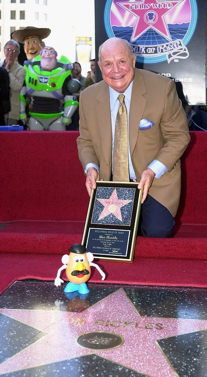 """. Actor/comedian Don Rickles smiles for photographers while receiving his star on the Hollywood Walk of Fame in Los Angeles Tuesday, Oct. 17, 2000. Rickles provides the voice of Mr. Potato Head for the film, \""""Toy Story.\""""  (AP Photo/Michael Caulfield)"""