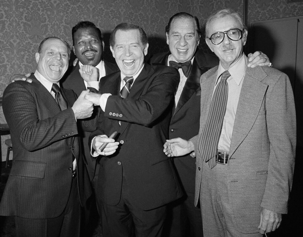 . Comedian Milton Berle, center, clowns with celebrities Don Rickles, left, Sugar Ray, Henny Youngman, and Jack Albertson, right, during the annual stag roast sponsored by the City of Hope in the Beverly Hilton Hotel in Beverly Hills, California on Thursday, Nov. 17, 1978. Proceeds went to the City of Hope which has established the Milton Berle Research fellowship in his honor. (AP Photo/ Doug Pizac)