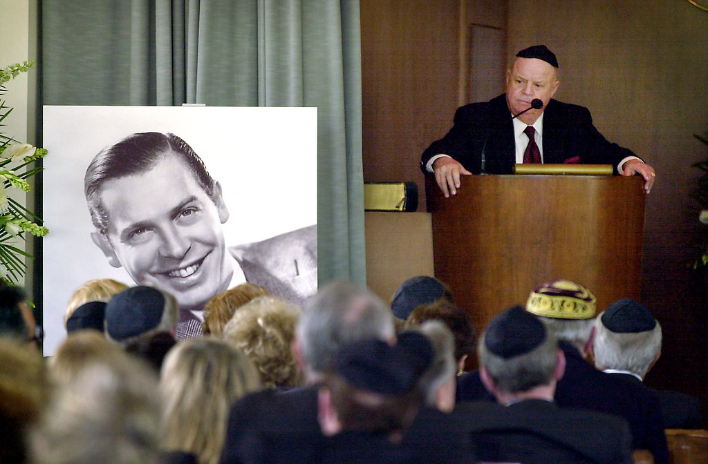 . Comedian Don Rickles speaks during a ceremony honoring comedian Milton Berle at Hillside Memorial Park and Mortuary in Los Angeles, Monday, April 1, 2002.  (AP Photo/Nick Ut)