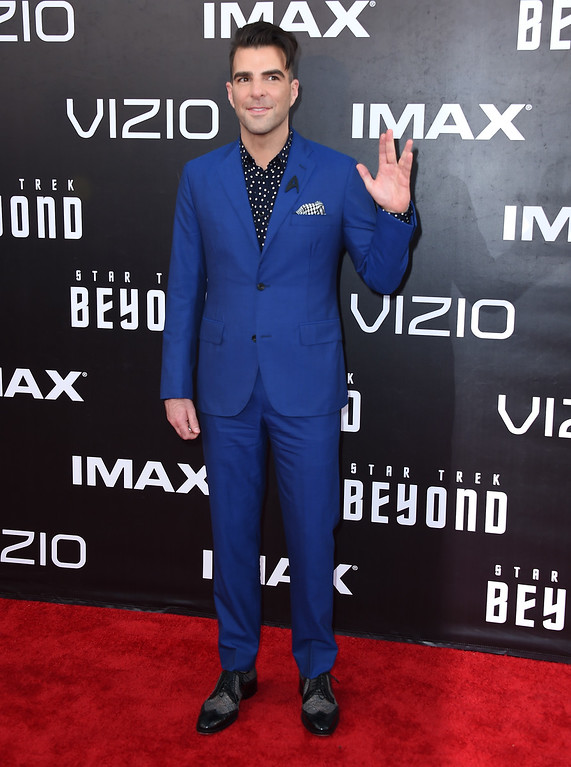 """. Zachary Quinto gives the Vulcan salute as he arrives at the world premiere of \""""Star Trek Beyond\"""" at the Embarcadero Marina Park South on Wednesday, July 20, 2016, in San Diego. (Photo by Jordan Strauss/Invision/AP)"""