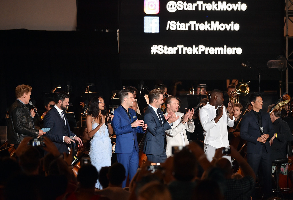 . SAN DIEGO, CA - JULY 20:  (L-R) TV personality Conan O\'Brien and actors Karl Urban, Zoe Saldana, Zachary Quinto, Chris Pine, Simon Pegg, Idris Elba, and John Cho speak onstage at the world premiere of the Paramount Pictures title ìStar Trek Beyondî at Embarcadero Marina Park South on July 20, 2016 in San Diego, California.  (Photo by Mike Windle/Getty Images)