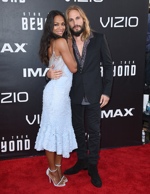 """. Zoe Saldana, left, and Marco Perego arrive at the world premiere of \""""Star Trek Beyond\"""" at the Embarcadero Marina Park South on Wednesday, July 20, 2016, in San Diego. (Photo by Jordan Strauss/Invision/AP)"""
