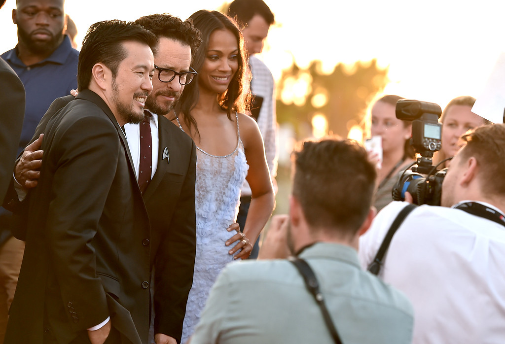 """. Justin Lin, from left, J.J. Abrams and Zoe Saldana pose for photographers as they arrive at the world premiere of \""""Star Trek Beyond\"""" at the Embarcadero Marina Park South on Wednesday, July 20, 2016, in San Diego. (Photo by Jordan Strauss/Invision/AP)"""