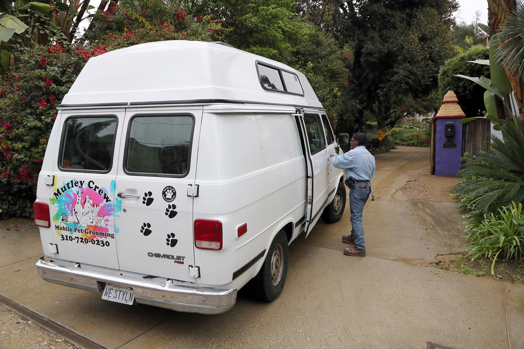 . A dog grooming van arrives at the homes of Debbie Reynolds and her daughter Carrie Fisher in Los Angeles, Thursday, Jan. 5, 2017.  Reynolds died Dec. 28 at the age of 84, a day after her daughter died at the age of 60. (AP Photo/Reed Saxon)