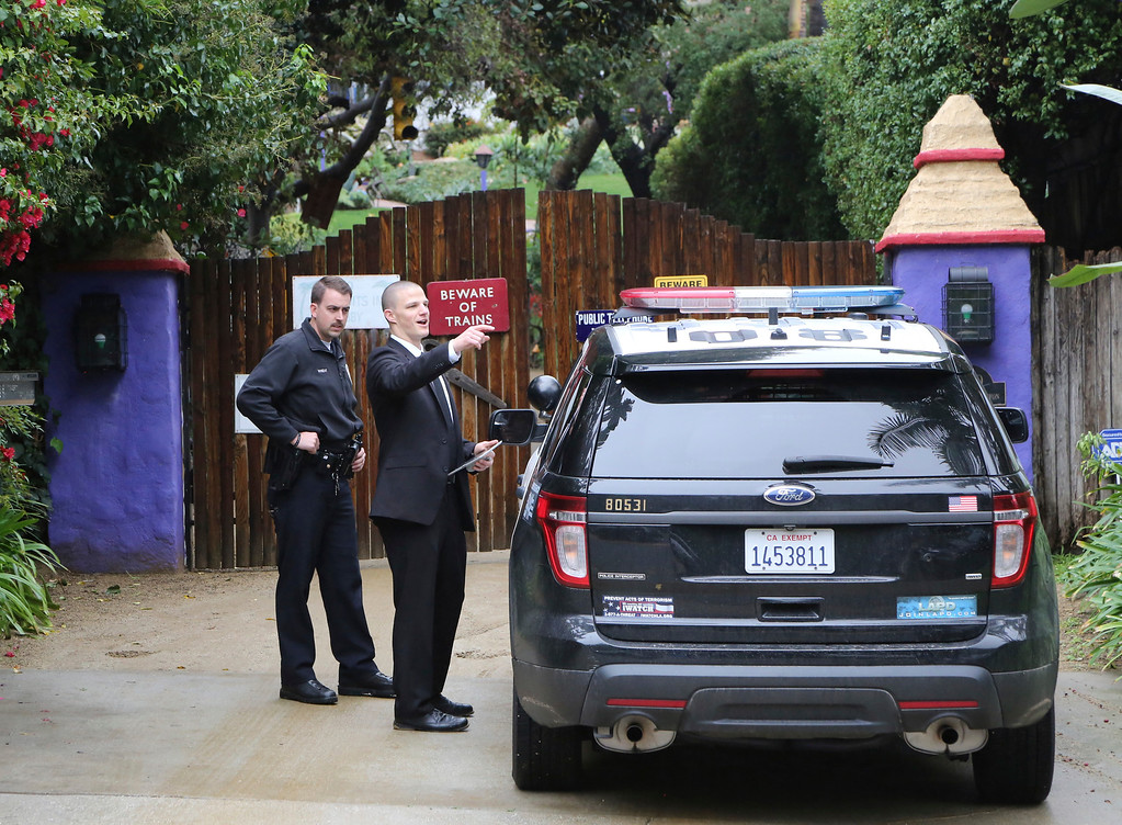 . Los Angeles police officers and private security appear outside the homes of Debbie Reynolds and her daughter Carrie Fisher in Los Angeles Thursday, Jan. 5, 2017. Reynolds died Dec. 28 at the age of 84, a day after her daughter died at the age of 60. (AP Photo/Reed Saxon)