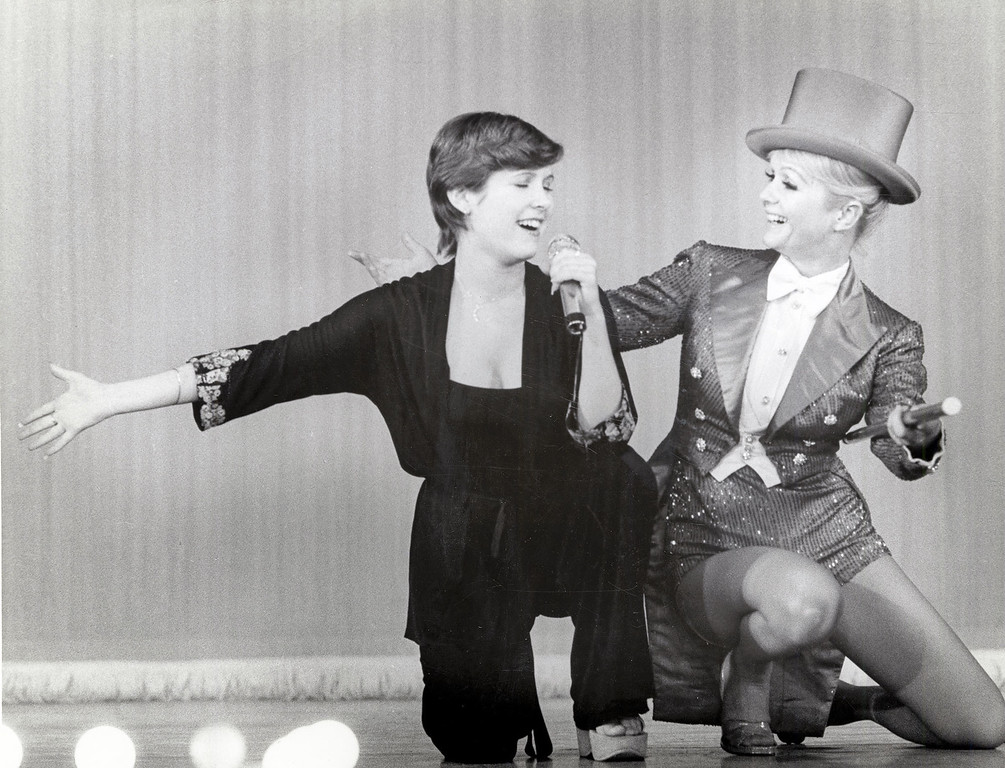 ". This image released by HBO shows Carrie Fisher, left, and her mother Debbie Reynolds from the HBO documentary, ""Bright Lights: Starring Carrie Fisher and Debbie Reynolds,\"" premiering Saturday, Jan. 7, 2017, at 8 p.m. ET/PT. (HBO via AP)"