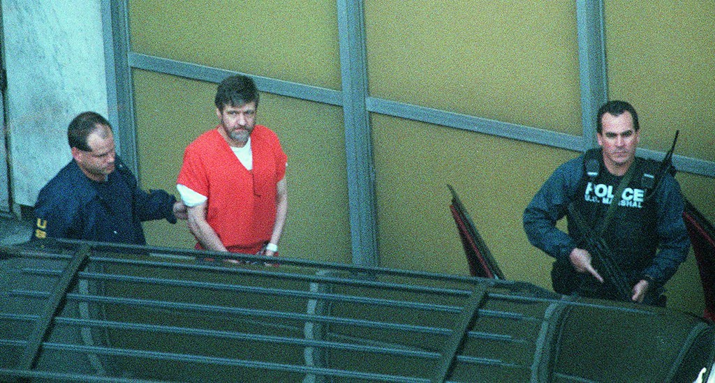 . File - Convicted Unabomber Theodore Kaczynski, center, is led from the Federal Courthouse in Sacramento, Calif., Thursday Jan. 22, 1998 following his guilty plea to all charges in the case. In return, Kaczynski will spend the rest of his life in prison without parole. (AP Photo/Bob Galbraith)