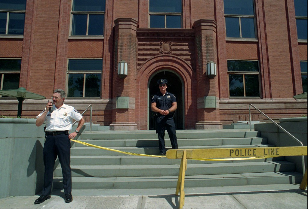 . File - Police stand guard outside the building on the Yale University campus in New Haven, Conn. in this June 25, 1993 photo, where a letter bomb exploded when Yale Prof. David Gelernter opened it June 24, 1993. The letter bomb was identified as being sent by the Unabomber.  (AP Photo/Stephen Castagneto/Files)