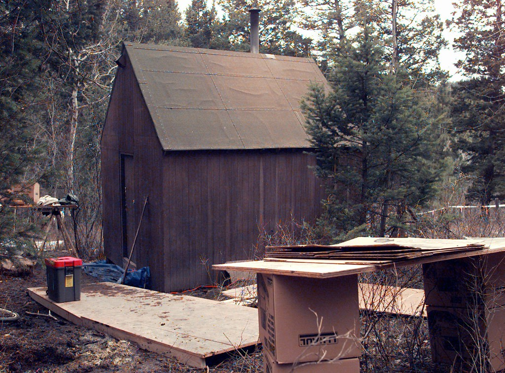 . File - Materials used by the FBI in its search of Theordore Kaczynski\'s mountain cabin in Lincoln, Mont., sit outside the cabin\'s door Saturday, April 6, 1996. Kaczynski was being investigated as the possible Unabomber.  (AP Photo/Elaine Thompson)