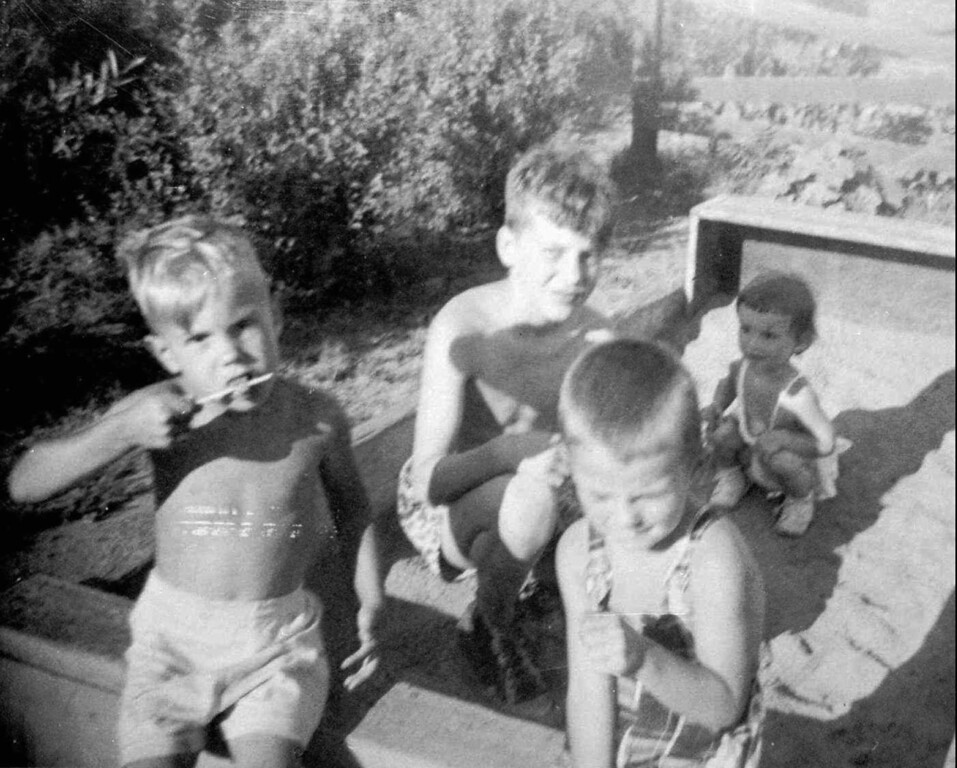 . David Kaczynski, left, and his older brother Theodore John Kaczynski, center, in a sandbox with neighbors Dan and Jan O\'Connell. Federal officials said Thursday, Jan. 22, 1998 that Unabomber suspect Theodore Kaczynski has agreed to plead guilty for a sentence of life in prison without parole. (AP Photo/Family Handout)