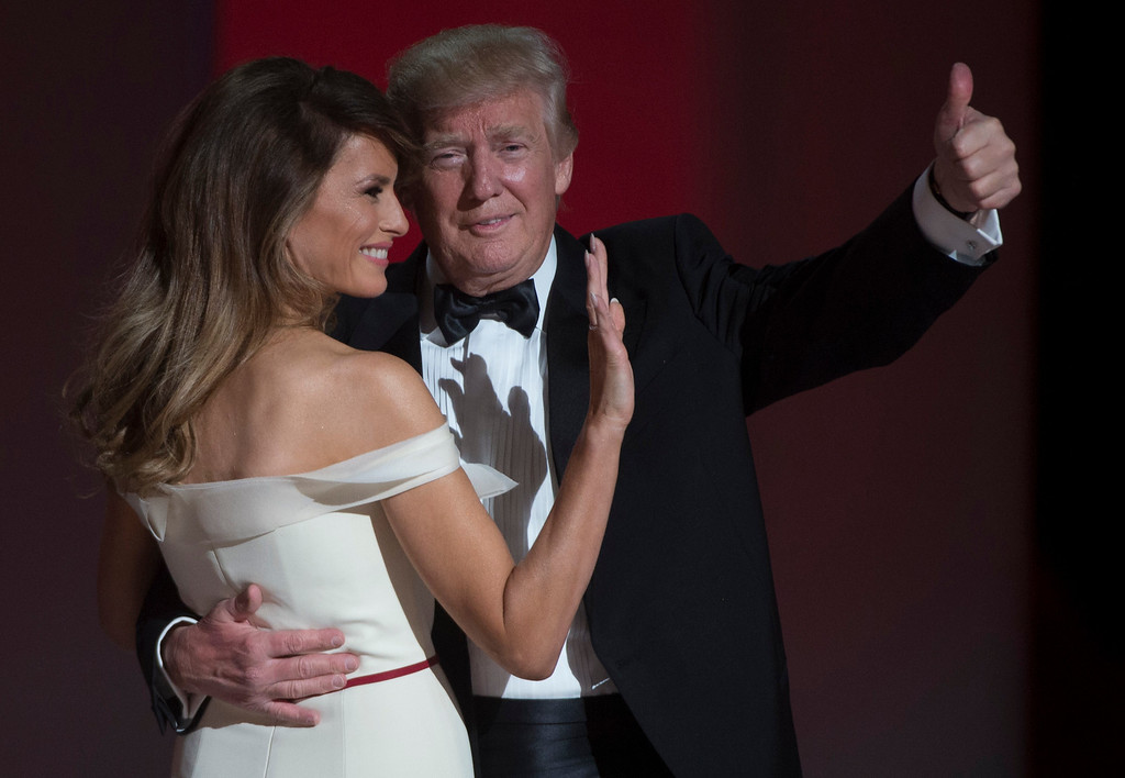 . US President Donald Trump and the first lady Melania Trump gesture after dancing at the Liberty Ball at the Washington DC Convention Center following Donald Trump\'s inauguration as the 45th President of the United States, in Washington, DC, on January 20, 2017.  (MOLLY RILEY/AFP/Getty Images)