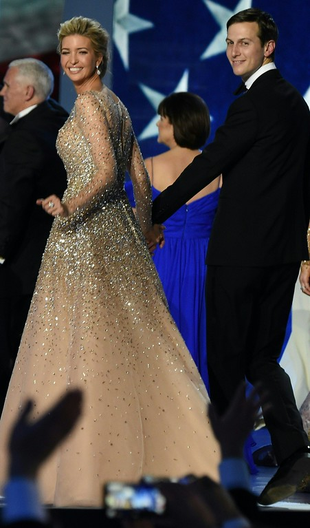 . Ivanka Trump and Jared Kushner salute the crowd after dancing on stage during the Freedom ball at the Walter E. Washington Convention Center on January 20, 2017 in Washington, DC. (ROBYN BECK/AFP/Getty Images)
