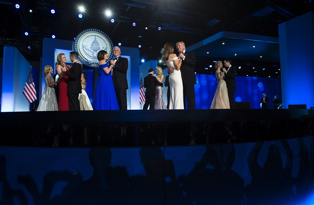 . US Vice President Mike Pence and Karen Pence and US President Donald Trump and US first lady Melania Trump dance with loved ones during the Freedom Ball January 20, 2017 in Washington, DC. (BRENDAN SMIALOWSKI/AFP/Getty Images)