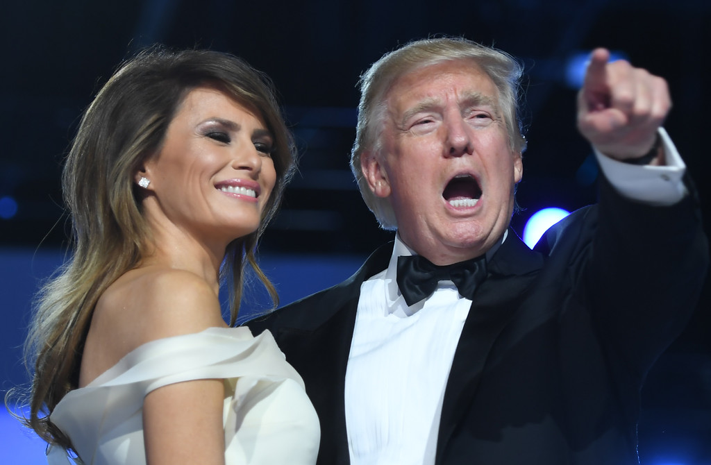 . US President Donald Trump gestures as first lady Melania Trump looks on during the Freedom Ball at the Washington DC Convention Center following Donald Trump\'s inauguration as the 45th President of the United States, in Washington, DC, on January 20, 2017.  (JIM WATSON/AFP/Getty Images)