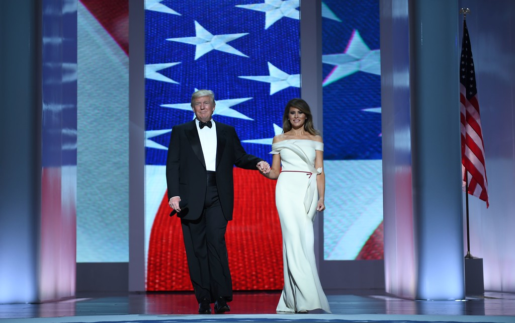 . US President Donald Trump and the first lady Melania Trump enter the Liberty Ball at the Washington DC Convention Center following Donald Trump\'s inauguration as the 45th President of the United States, in Washington, DC, on January 20, 2017.  (JIM WATSON/AFP/Getty Images)