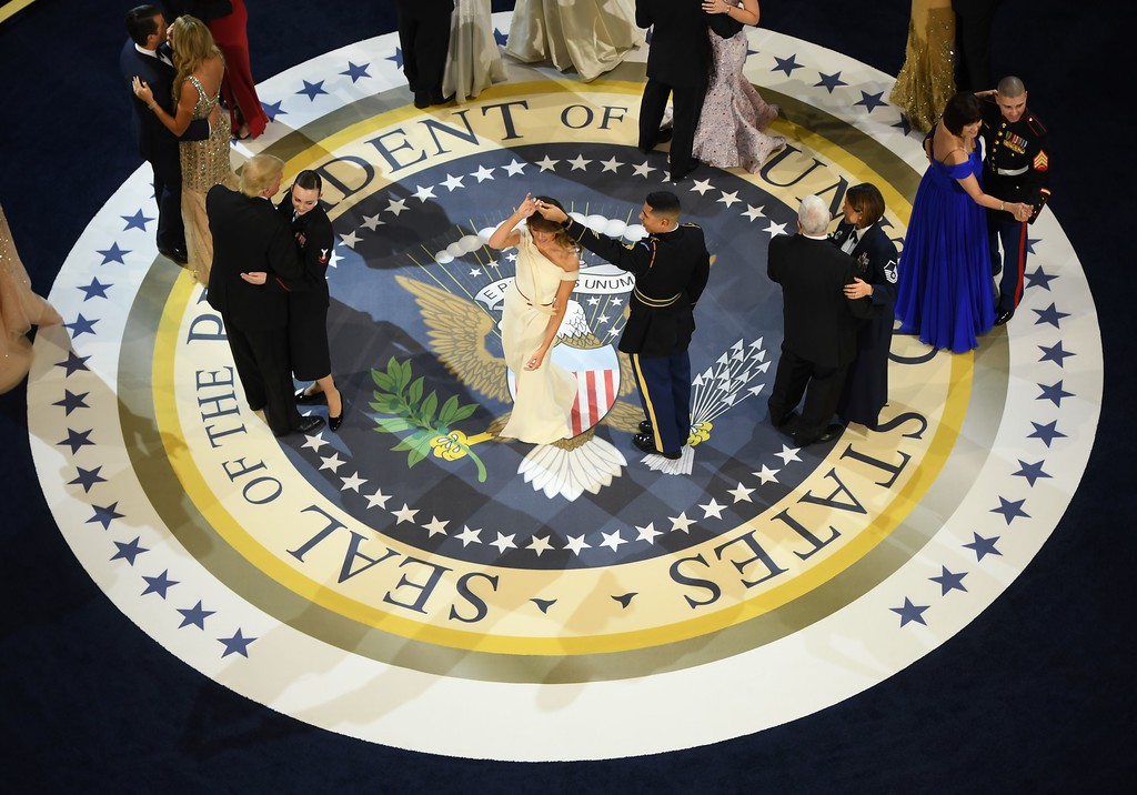 . US President Donald Trump, the first lady Melania Trump, US Vice President Mike Pence, and his wife Karen dance with members of the military at the Armed Services ball at the National Building museum following Donald Trump\'s inauguration as the 45th President of the United States, in Washington, DC, on January 20, 2017.  (JIM WATSON/AFP/Getty Images)