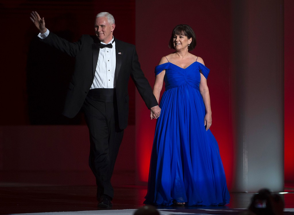 . US Vice President Mike Pence, and his wife Karen arrive at the Liberty Ball at the Washington DC Convention Center following Donald Trump\'s inauguration as the 45th President of the United States, in Washington, DC, on January 20, 2017.  / AFP / MOLLY RILEY        (Photo credit should read MOLLY RILEY/AFP/Getty Images)