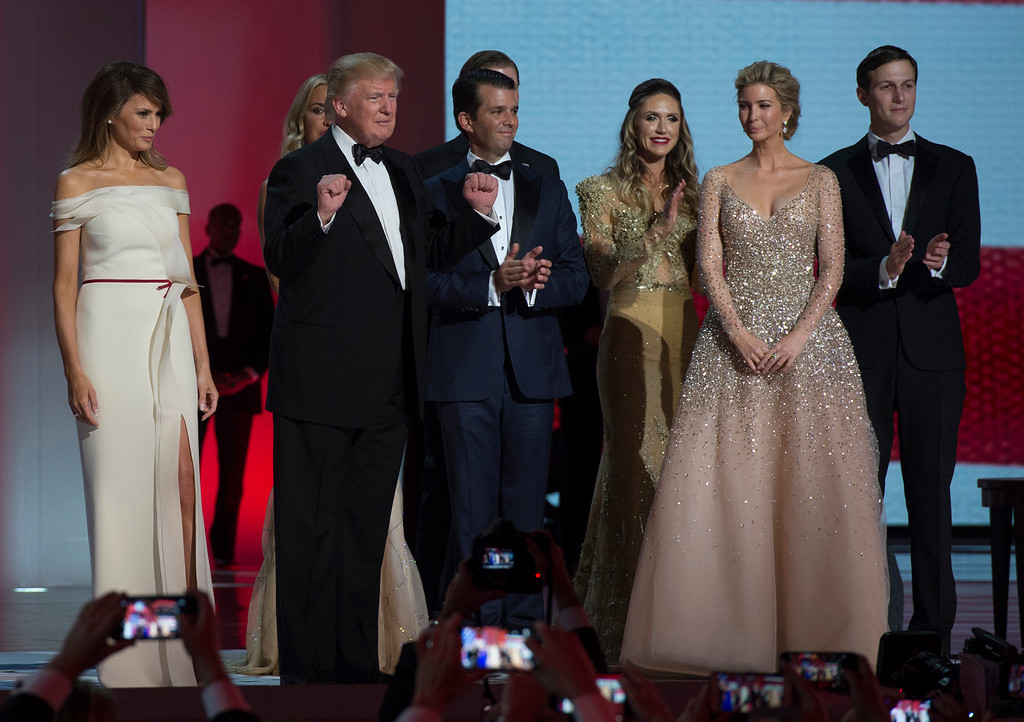 . US President Donald Trump (2L) gestures as the first lady Melania Trump (L) and Trumps family look on at the Liberty Ball at the Washington DC Convention Center following Donald Trump\'s inauguration as the 45th President of the United States, in Washington, DC, on January 20, 2017.  / AFP / MOLLY RILEY        (Photo credit should read MOLLY RILEY/AFP/Getty Images)