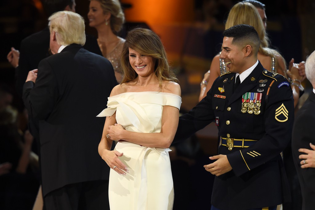 . US First Lady Melania Trump (C) dances with a member of the Marine Corps (R) during the Salute to Our Armed Services Inaugural Ball at the National Building Museum in Washington, DC, January 20, 2017. (SAUL LOEB/AFP/Getty Images)