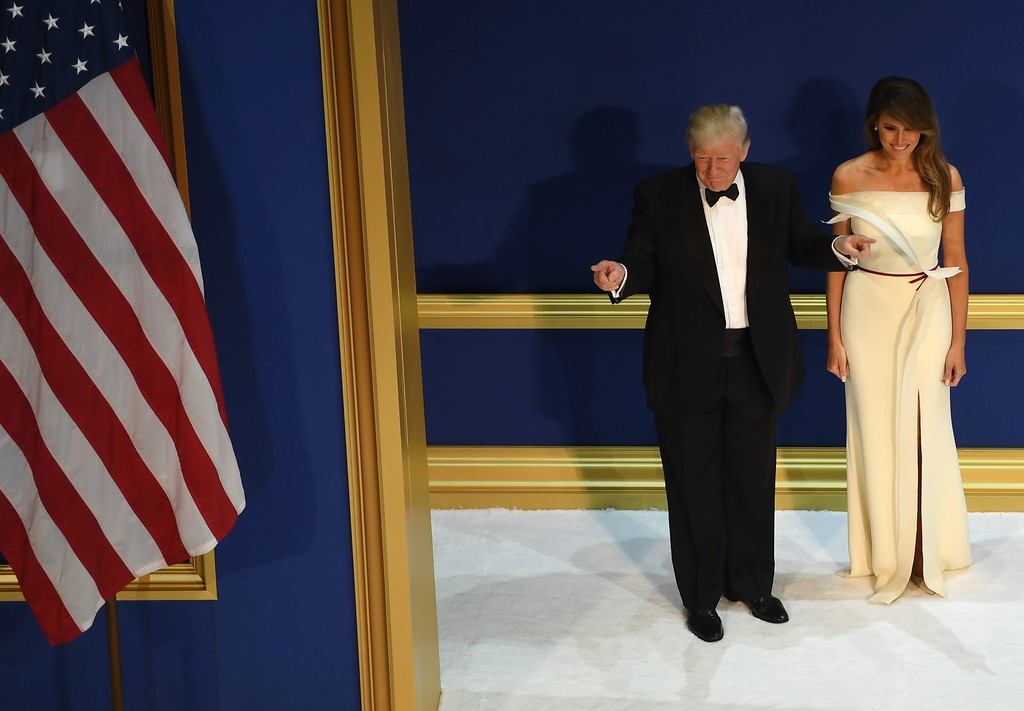 . US President Donald Trump and the first lady Melania Trump arrive at the Armed Services ball at the National Building museum following Donald Trump\'s inauguration as the 45th President of the United States, in Washington, DC, on January 20, 2017.  (JIM WATSON/AFP/Getty Images)
