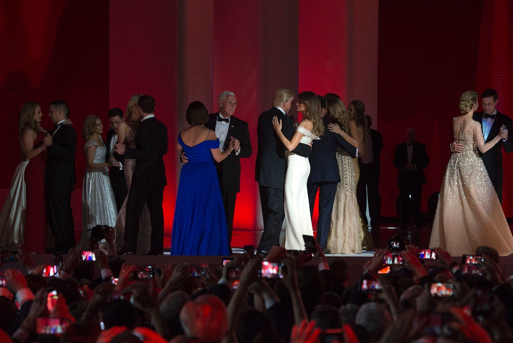 . US President Donald Trump (center L) and the first lady Melania Trump (center R) dance with Vice Presidant Mike Pence (8L), his wife Karen (L) and family  at the Liberty Ball at the Washington DC Convention Center following Donald Trump\'s inauguration as the 45th President of the United States, in Washington, DC, on January 20, 2017.  / AFP / MOLLY RILEY        (Photo credit should read MOLLY RILEY/AFP/Getty Images)