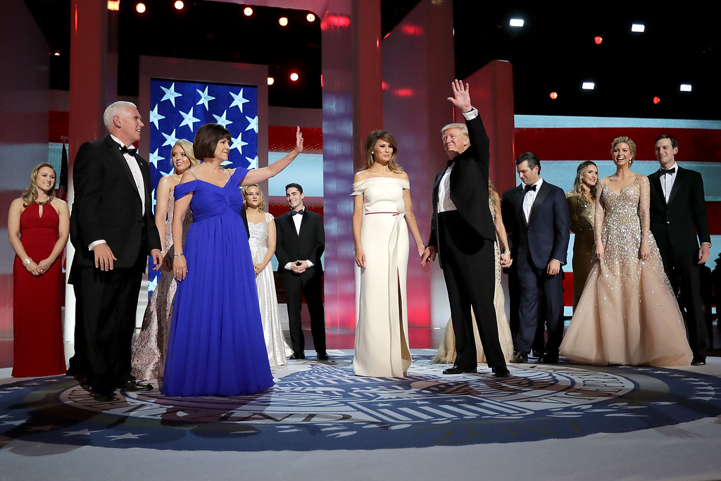 . WASHINGTON, DC - JANUARY 20:  U.S. President Donald Trump, first lady Melania Trump, U.S. Vice President Mike Pence, his wife Karen Pence and their families dance during the inaugural Liberty Ball at the Washington Convention Center January 20, 2017 in Washington, DC. The ball is part of the celebrations following the inauguration of Pence and U.S. President Donald J. Trump.  (Photo by Chip Somodevilla/Getty Images)